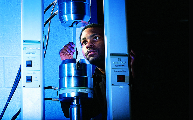 Man working on testing equipment